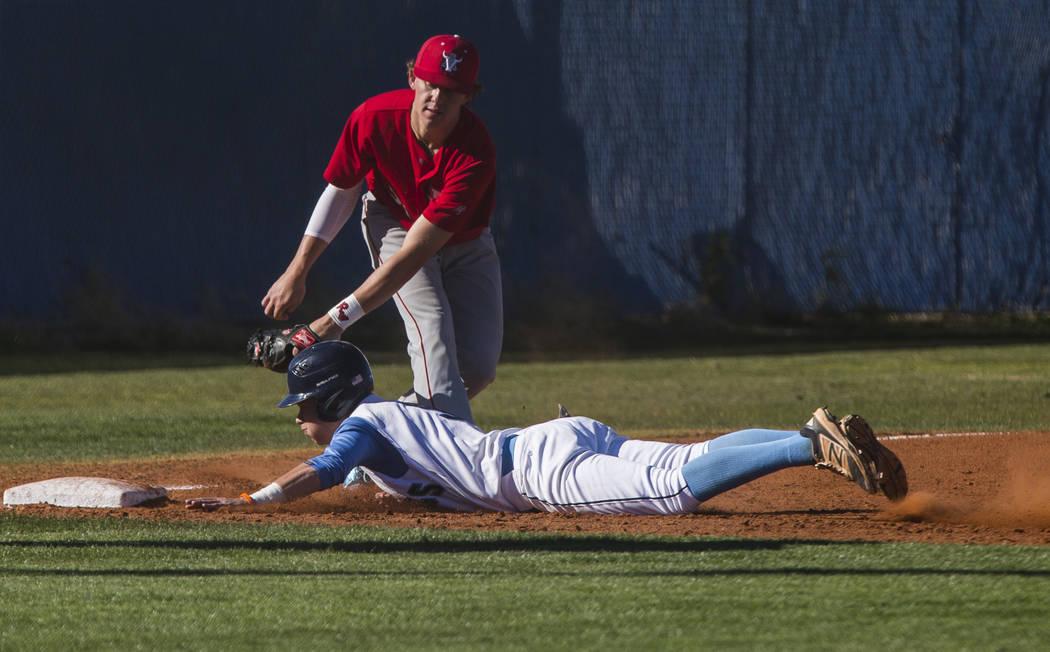 Arbor View infielder Austin Pfeifer tags Centennial's Payton Moody out at third base during the third inning at Centennial Hills High School in Las Vegas on Friday, March 23, 2018. Centennial won  ...