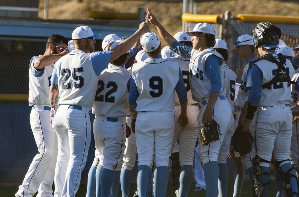 Centennial players come together in a huddle at the conclusion of the fourth inning at Centennial Hills High School in Las Vegas on Friday, March 23, 2018. Centennial won 11-2.  Patrick Connolly L ...