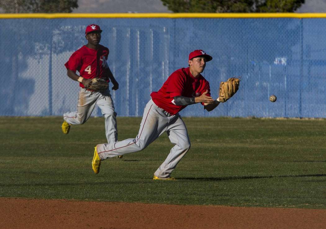 Arbor View infielder Nick Cornman fails to catch a pop fly while outfielder Deangelo Smith runs after him while playing against Centennial during the sixth inning at Centennial Hills High School i ...