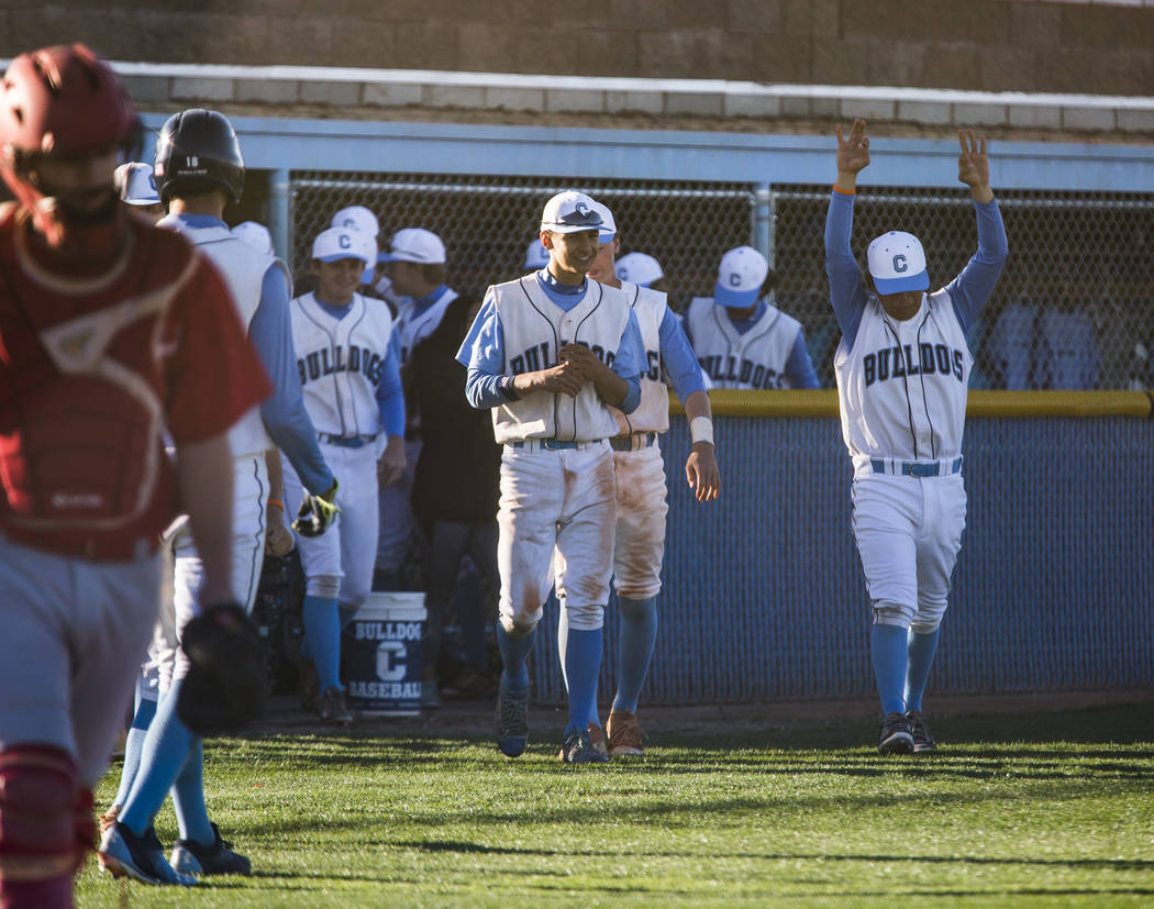 Centennial players celebrate after defeating Arbor View 11-2 at Centennial Hills High School in Las Vegas on Friday, March 23, 2018.  Patrick Connolly Las Vegas Review-Journal @PConnPie