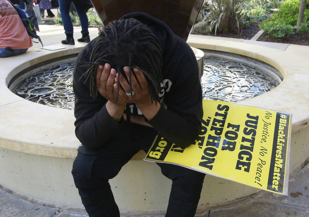 Andre Young, who says he is a cousin of shooting victim Stephon Alonzo Clark, holds his head in his hands during a demonstration, Thursday, March 22, 2018, over the shooting death of Clark by Sacr ...