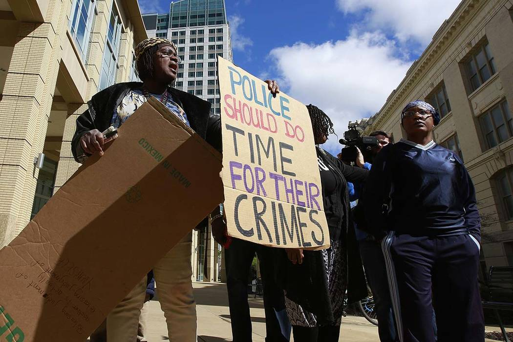 Demonstrators gathered outside Sacramento City Hall to protest the shooting of Stephon Alonzo Clark, by a pair of Sacramento Police officers, during a demonstration, Thursday, March 22, 2018, in S ...