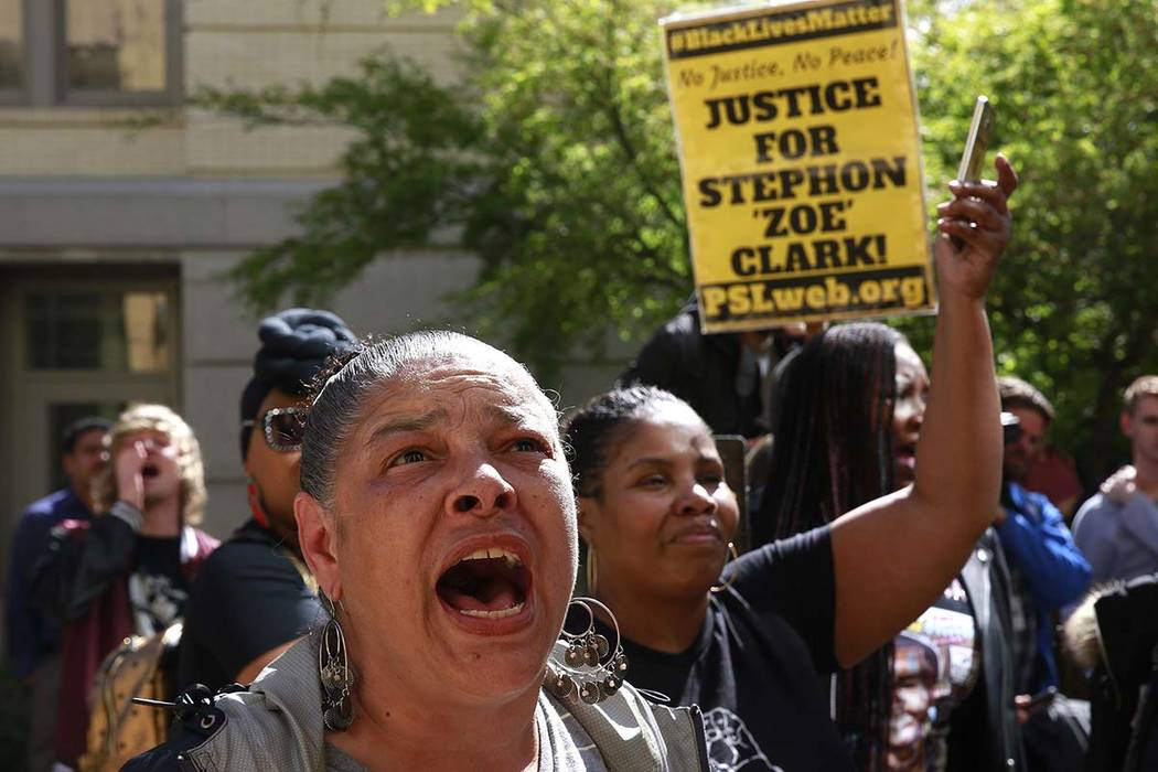 Allegra Taylor, left, and other protestors gathered outside Sacramento City Hall to protest the shooting of Stephon Alonzo Clark, by a pair of Sacramento Police officers, during a demonstration, T ...