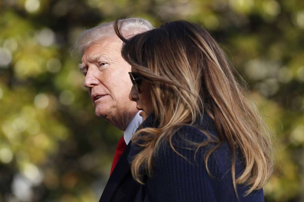 In this March 19, 2018, photo, President Donald Trump, accompanied by first lady Melania Trump, walks on the South Lawn of the White House in Washington. (Alex Brandon/AP)