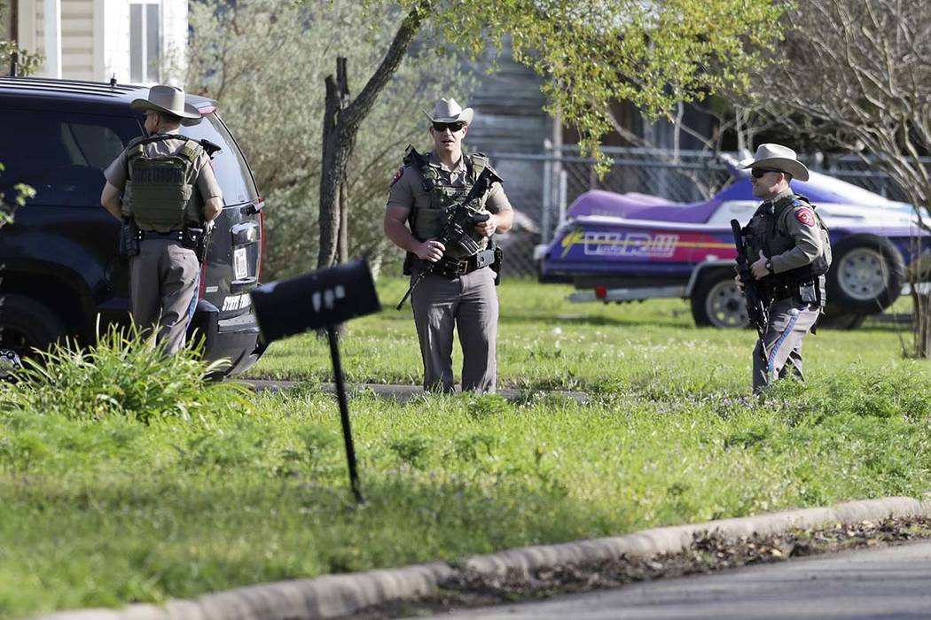 Law enforcement officers secure the neighborhood at the scene of Walnut and 2nd Street in Pflugerville, Texas, on Wednesday, March 21, 2018 where Austin, Texas bombing suspect Mark Anthony Conditt ...
