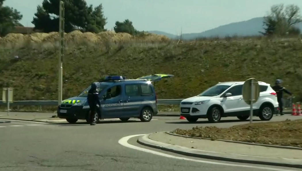 In this image taken from BFM TV shows a police vehicle parked on a crossroad in Trebes, southern France, near the scene of an incident, Friday March 23, 2018. French counterterrorism prosecutors a ...
