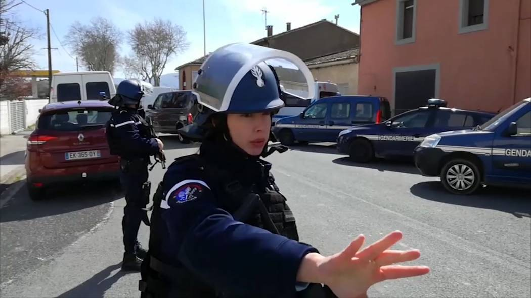 In this image taken from La Depeche Du Midi, police attend an incident in Trebes, southern France, Friday March 23, 2018. French counterterrorism prosecutors are taking charge of the investigation ...