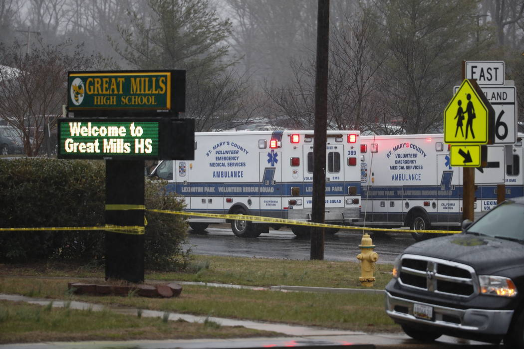 Deputies, federal agents and rescue personnel, converge on Great Mills High School, the scene of a shooting, Tuesday morning, March 20, 2018 in Great Mills, Md. (Alex Brandon/AP)