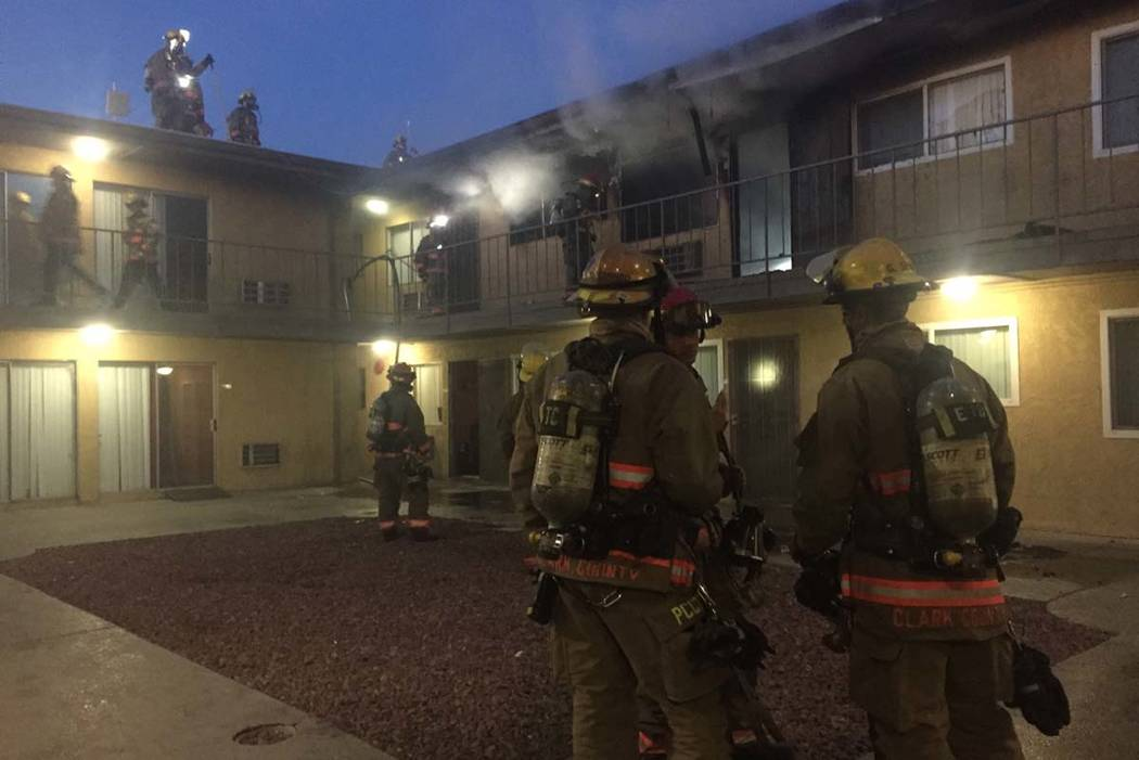Clark County firefighters work to put out a blaze Friday morning at Siegel Suites Twain II Apartments at 905 E. Twain Ave. (Clark County Fire Department)