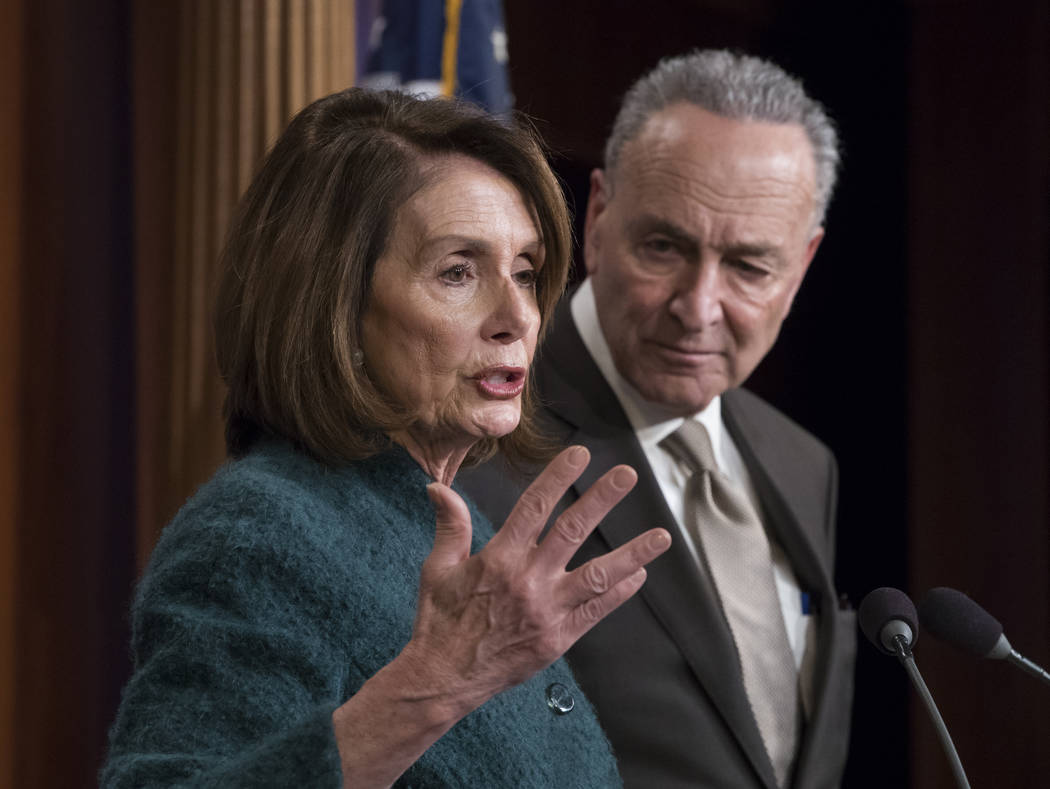 House Minority Leader Nancy Pelosi, D-Calif., and Senate Minority Leader Chuck Schumer, D-N.Y., speak to reporters about the massive government spending bill moving through Congress, on Capitol Hi ...
