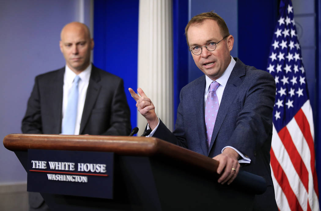 Office of Management and Budget Director Mick Mulvaney, right, with White House Director of Legislative Affairs and Assistant Marc Short, talks to reporters in the Brady press briefing room at the ...