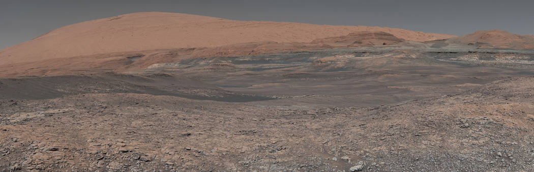 This image provided by NASA, assembled from a series of January 2018 photos made by the Mars Curiosity rover, shows an uphill view of Mount Sharp, which Curiosity has been climbing. Spanning the c ...