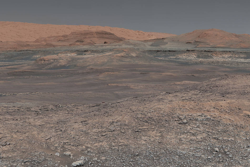 This image provided by NASA, assembled from a series of January 2018 photos made by the Mars Curiosity rover, shows an uphill view of Mount Sharp, which Curiosity has been climbing. (NASA/JPL-Calt ...