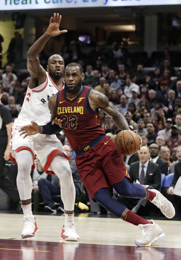 Cleveland Cavaliers' LeBron James (23) drives past Toronto Raptors' Serge Ibaka (9) during the second half of an NBA basketball game Wednesday, March 21, 2018, in Cleveland. The Cavaliers won 132- ...