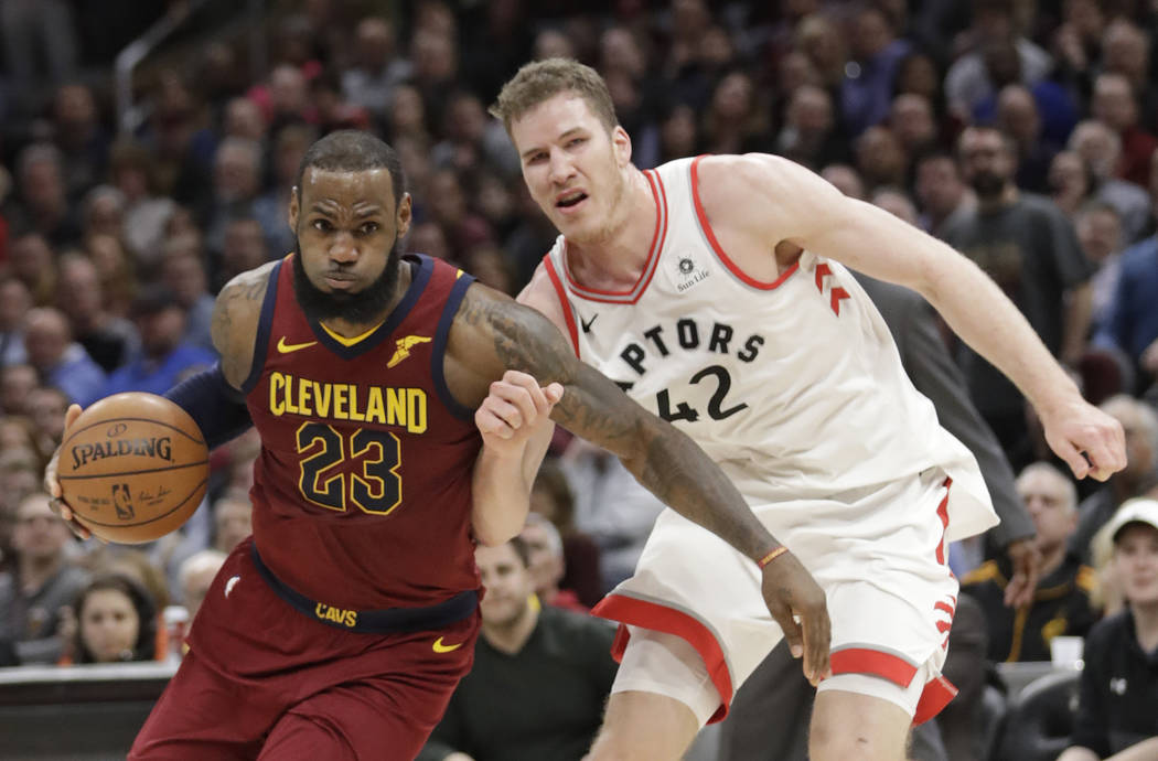 Cleveland Cavaliers' LeBron James (23) drives past Toronto Raptors' Jakob Poeltl (42) during the second half of an NBA basketball game Wednesday, March 21, 2018, in Cleveland. The Cavaliers won 13 ...