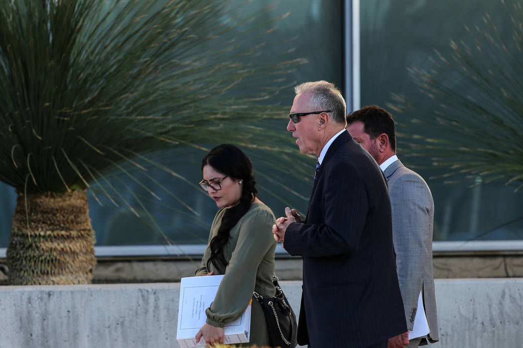 Edward Levine, center, leaves the federal courthouse with his defense lawyers, Todd Leventhal, right, and Carmen Martinez, after receiving a guilty verdict for illegally selling the horns of an en ...