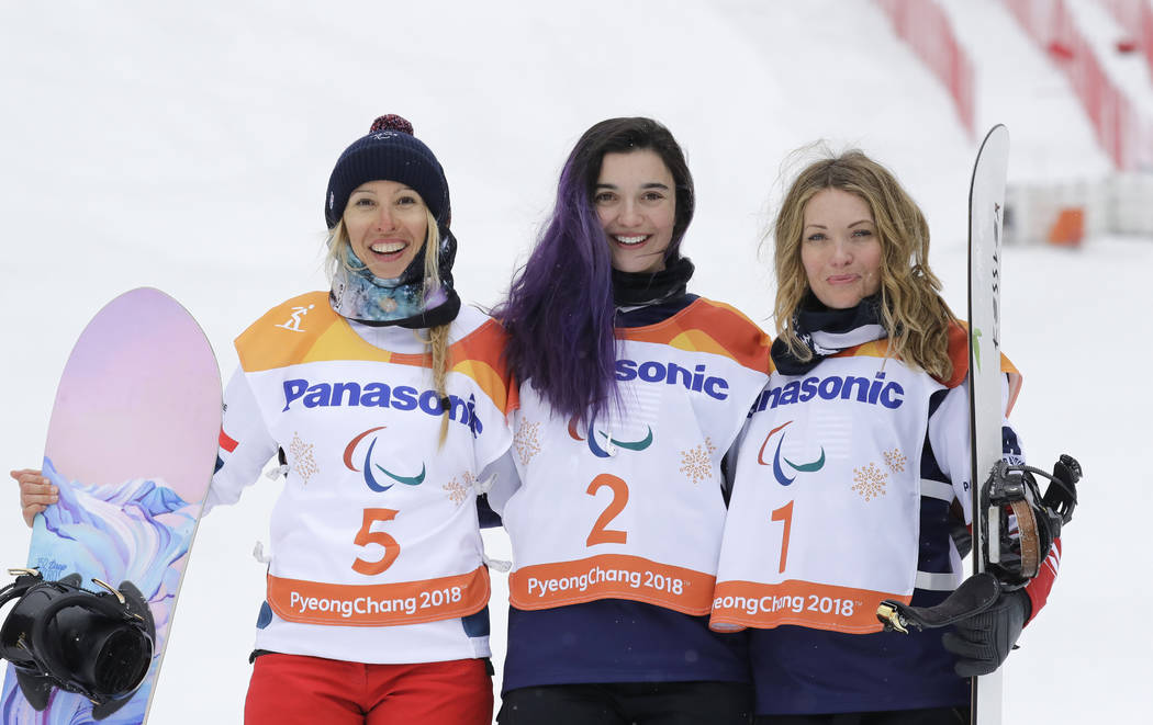 Gold medal winner Brenna Huckaby of the United States, center, silver medalist Cecile Hernandez of France, left, and bronze medalist Amy Purdy of the United States pose for the media during the vi ...