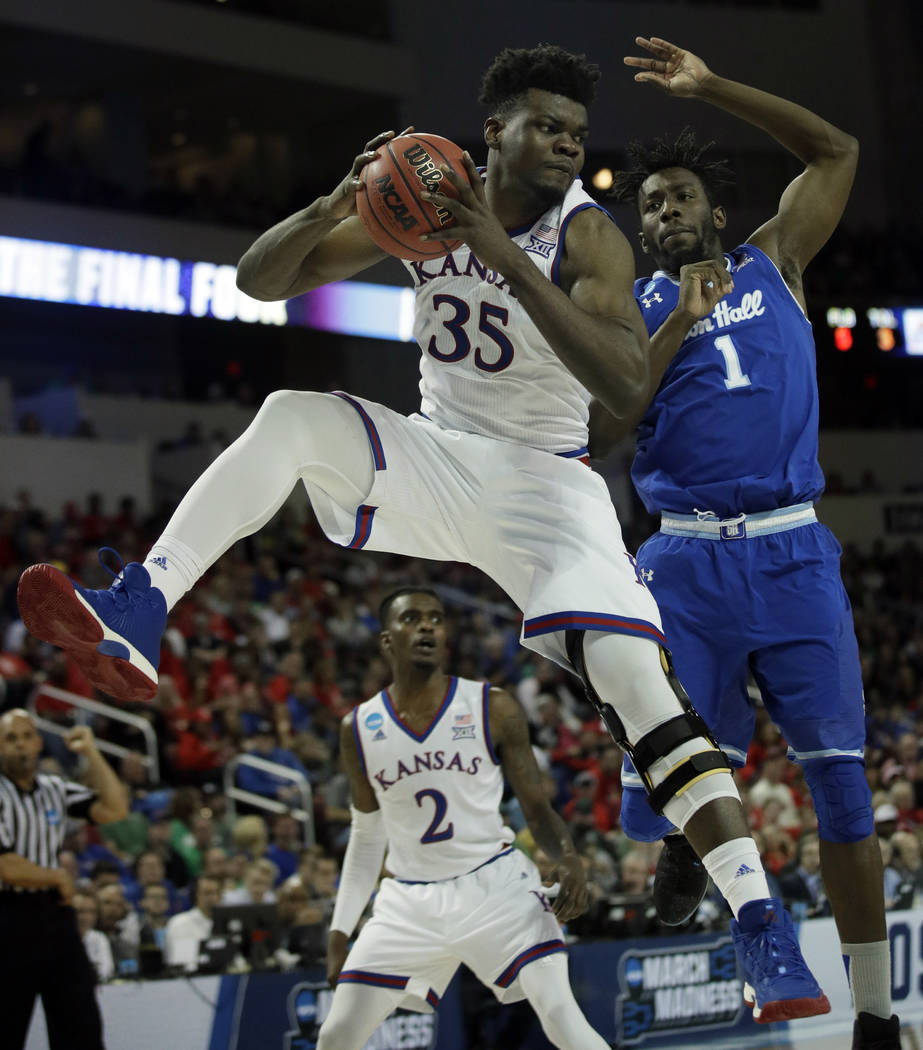 Kansas center Udoka Azubuike (35) rebounds against Seton Hall forward Michael Nzei (1) during the second half of an NCAA men's college basketball tournament second-round game, Saturday, March 17,  ...