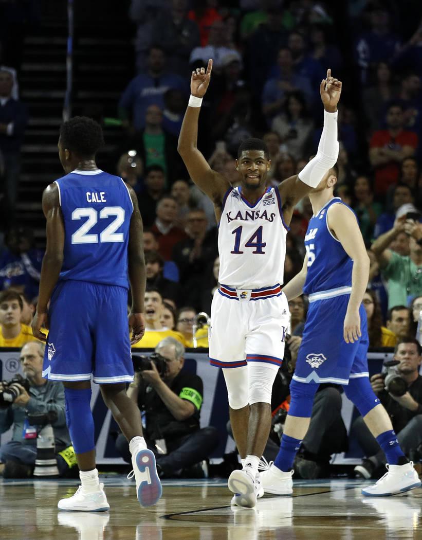Kansas guard Malik Newman (14) celebrates after an NCAA men's college basketball tournament second-round game against Seton Hall Saturday, March 17, 2018, in Wichita, Kan. Kansas won 83-79. (AP Ph ...