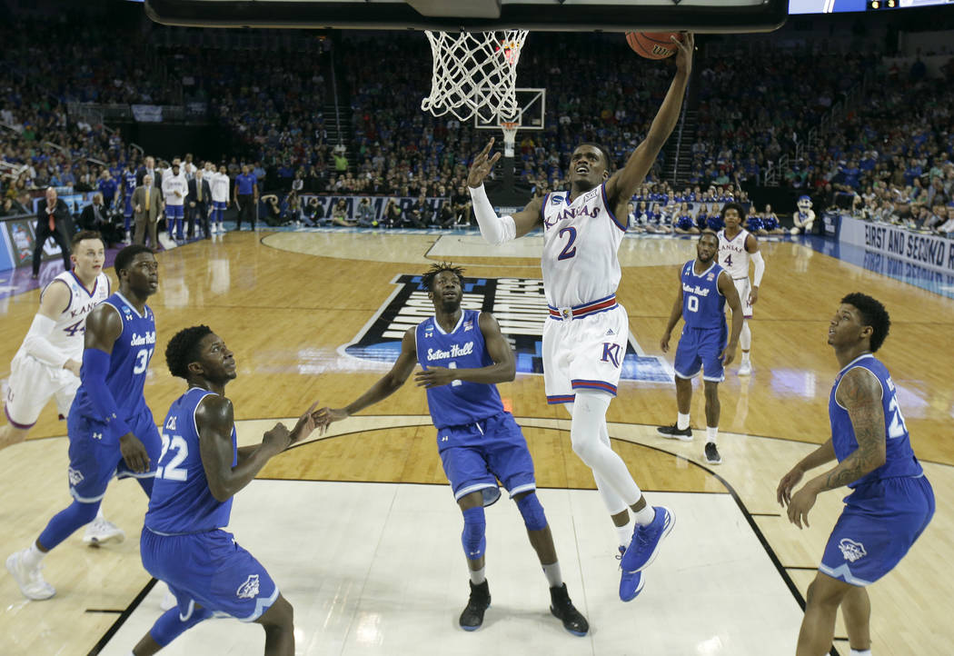 Kansas guard Lagerald Vick (2) puts up a shot during the second half of an NCAA men's college basketball tournament second-round game against Seton Hall Saturday, March 17, 2018, in Wichita, Kan.  ...