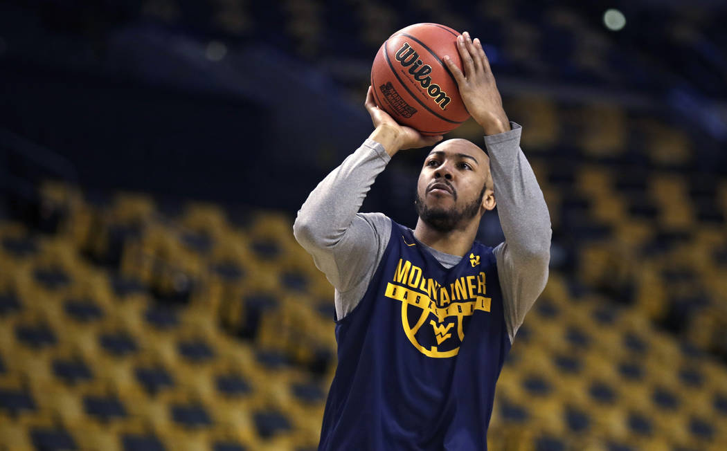 West Virginia's Jevon Carter shoots during practice at the NCAA men's college basketball tournament in Boston, Thursday, March 22, 2018. West Virginia faces Villanova in a regional semifinal on Fr ...