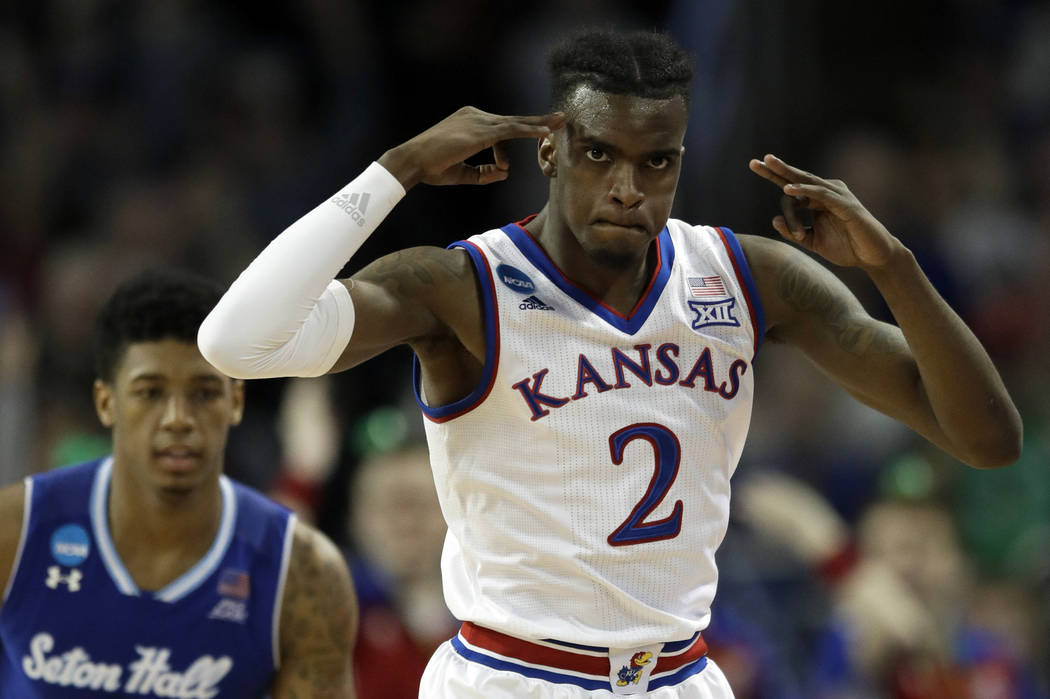 Kansas guard Lagerald Vick (2) celebrates a three-point basket in front of Seton Hall forward Desi Rodriguez (20) during the second half of an NCAA men's college basketball tournament second-round ...