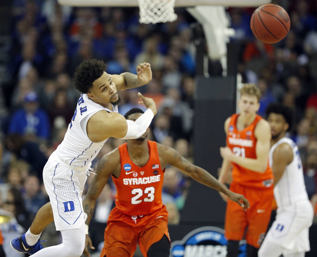 Duke's Gary Trent Jr. reaches for a loose ball during the second half of a regional semifinal game against Syracuse in the NCAA men's college basketball tournament Friday, March 23, 2018, in Omaha ...