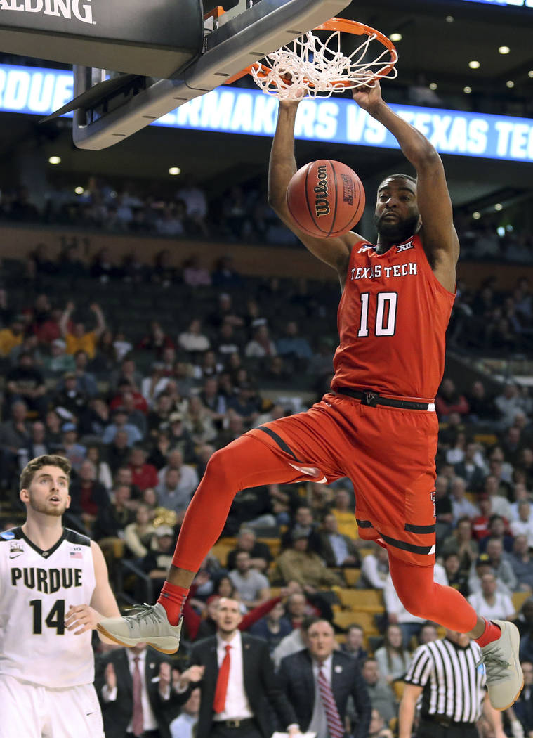 Texas Tech's Niem Stevenson dunks in front of Purdue's Ryan Cline during the second half of an NCAA men's college basketball tournament regional semifinal, Friday, March 23, 2018, in Boston. (AP P ...
