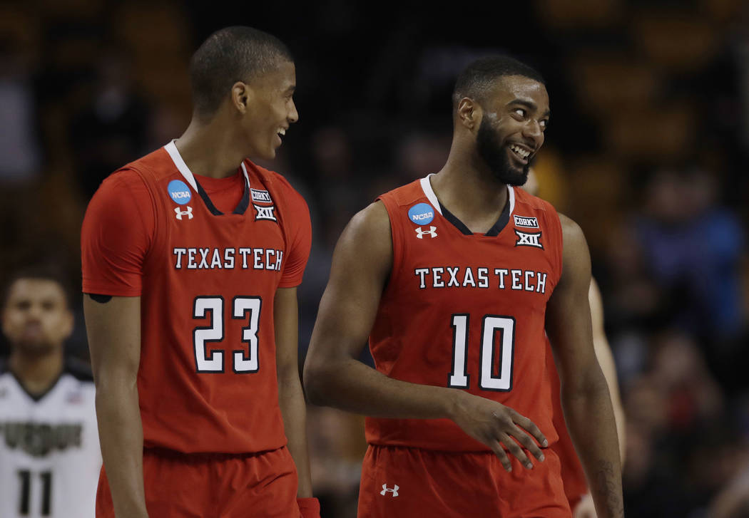 Texas Tech's Jarrett Culver, left, and Niem Stevenson smile at the end of the team's 78-65 victory over Purdue in an NCAA men's college basketball tournament regional semifinal, early Saturday, Ma ...