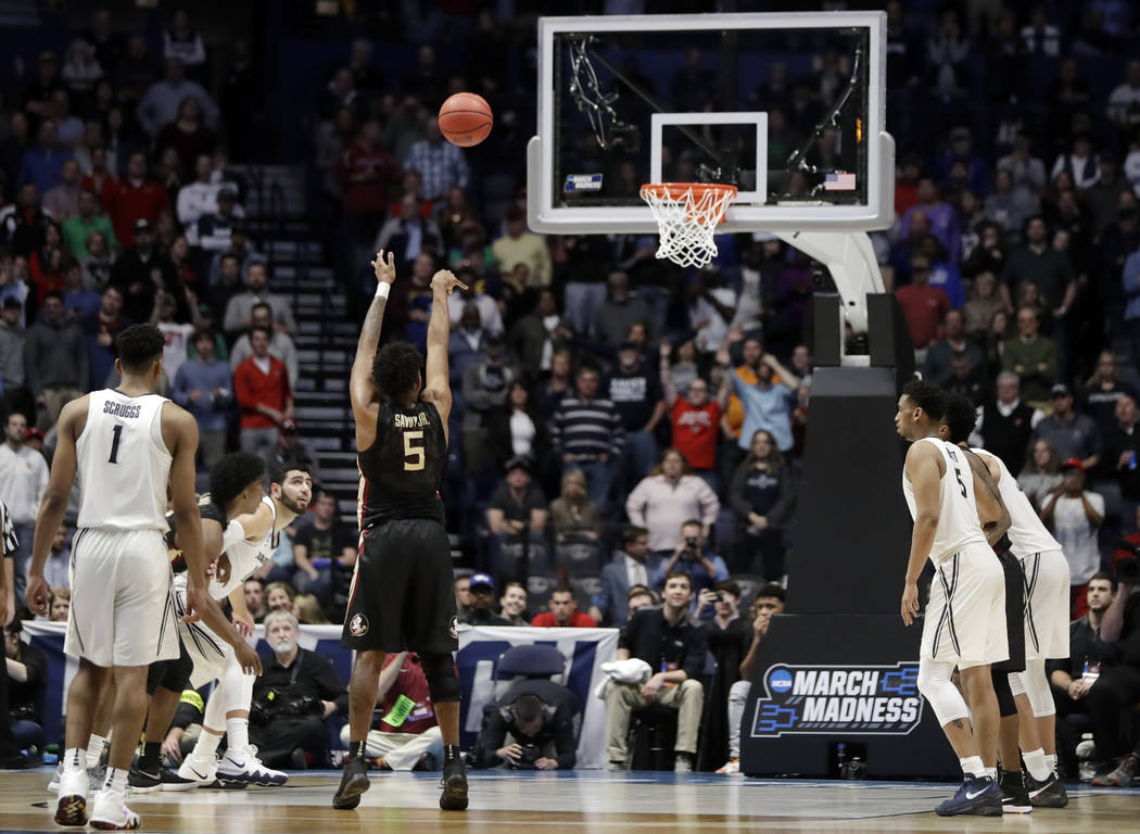Florida State guard PJ Savoy (5) aims a free throw shot, during the second half of a second-round game against the Xavier, in the NCAA college basketball tournament in Nashville, Tenn., Sunday, Ma ...