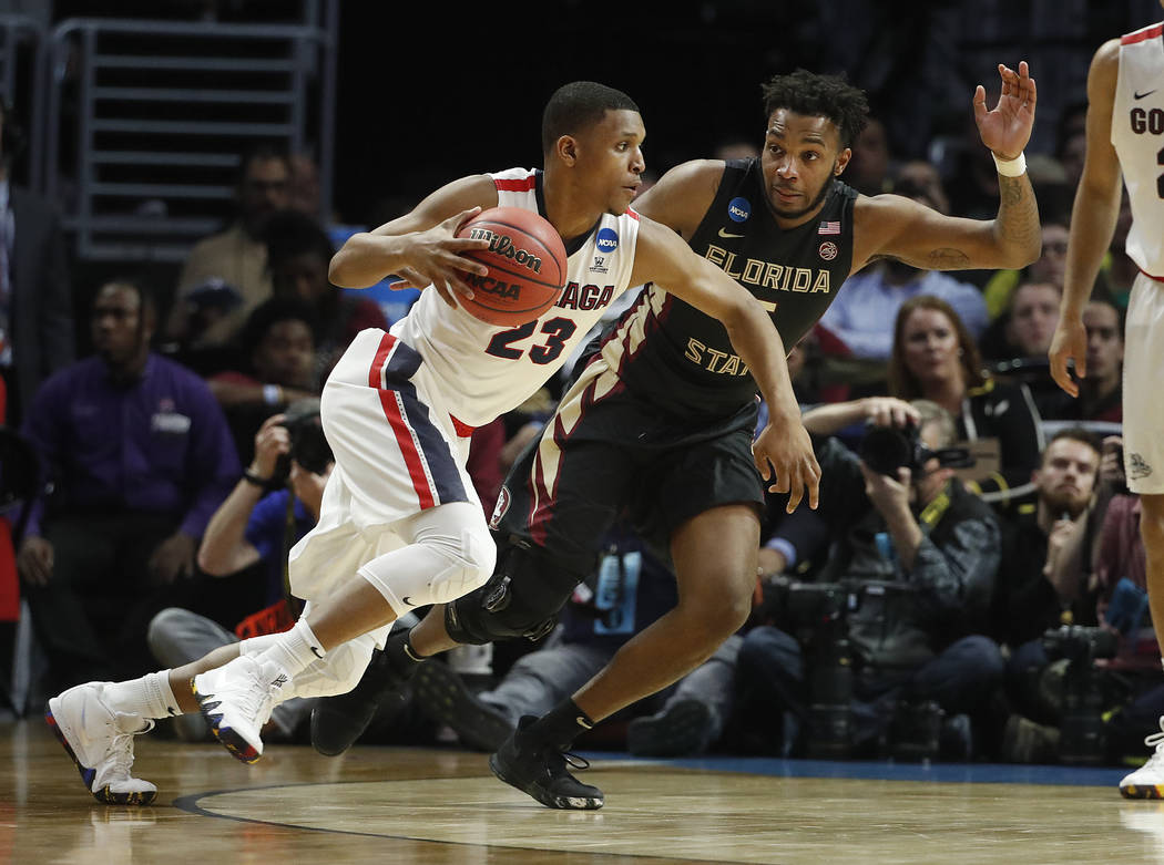 Gonzaga guard Zach Norvell Jr. (23) drives against Florida State guard PJ Savoy during the first half of an NCAA men's college basketball tournament regional semifinal Thursday, March 22, 2018, in ...