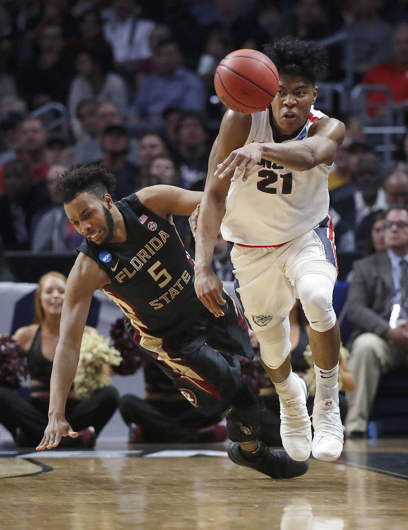 Gonzaga forward Rui Hachimura (21) passes the ball in front of Florida State guard PJ Savoy (5) during the first half of an NCAA men's college basketball tournament regional semifinal Thursday, Ma ...