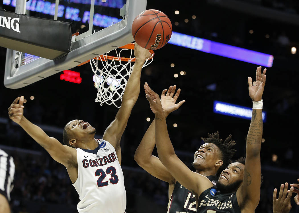 Gonzaga guard Zach Norvell Jr. (23) reaches for a rebound over Florida State center Ike Obiagu, center, and PJ Savoy during the first half of an NCAA men's college basketball tournament regional s ...