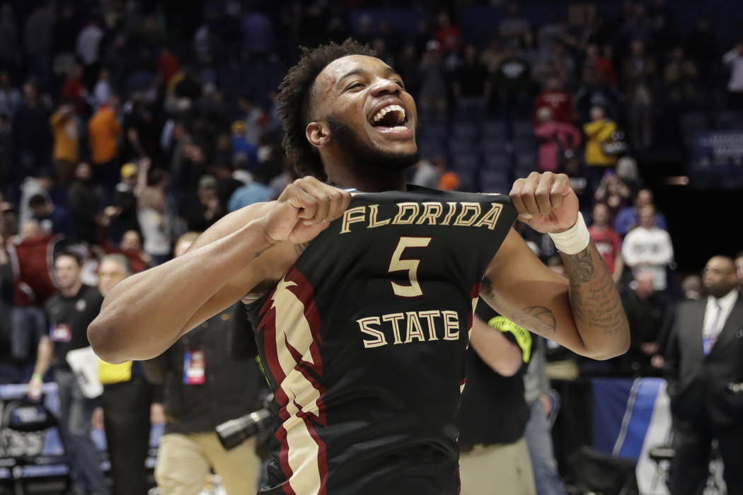 Florida State guard PJ Savoy (5), celebrates after defeating Xavier in a second-round game in the NCAA college basketball tournament in Nashville, Tenn., Sunday, March 18, 2018. Florida State defe ...