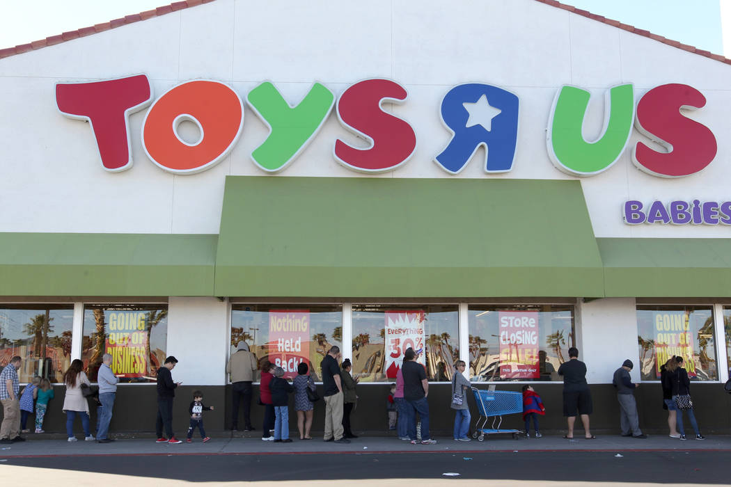 Shoppers line up before opening at the Toys R Us at 1425 W. Sunset Road in Henderson for the first day of their liquidation sale Friday, March 23, 2018. Toys R Us will sell or close all of its U.S ...