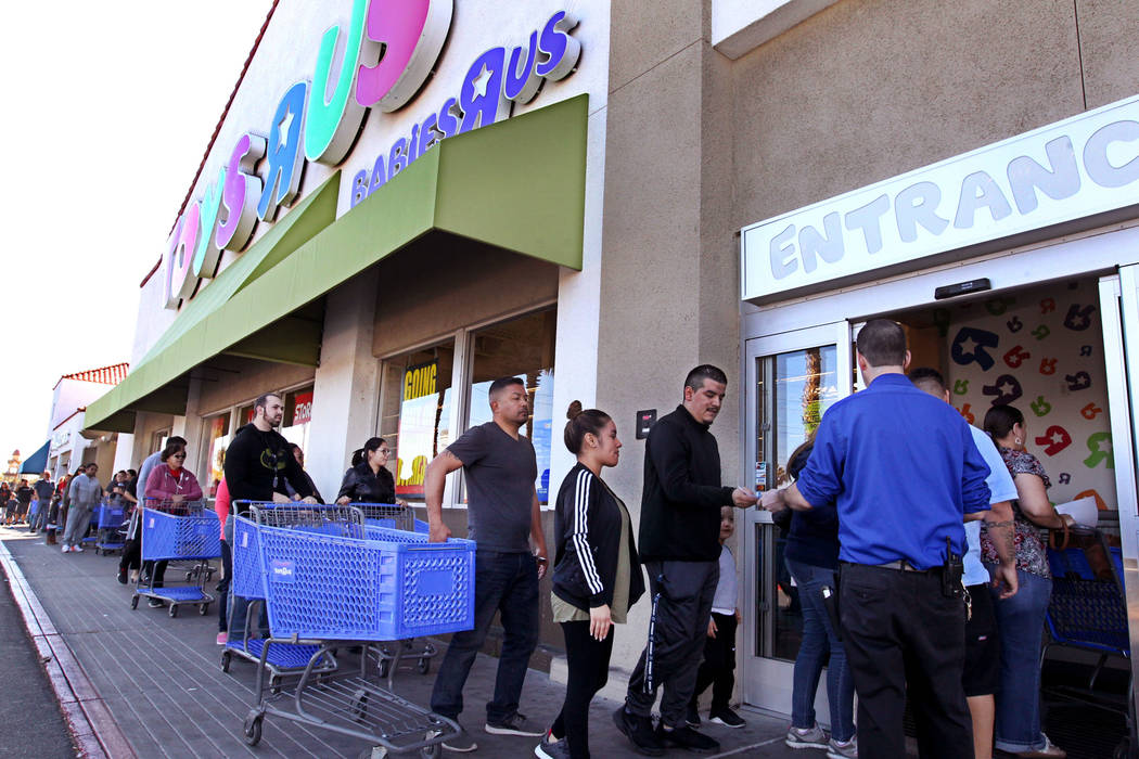 Shoppers file into the Toys R Us at 1425 W. Sunset Road in Henderson for the first day of their liquidation sale Friday, March 23, 2018. Toys R Us will sell or close all of its U.S. stores. K.M. C ...