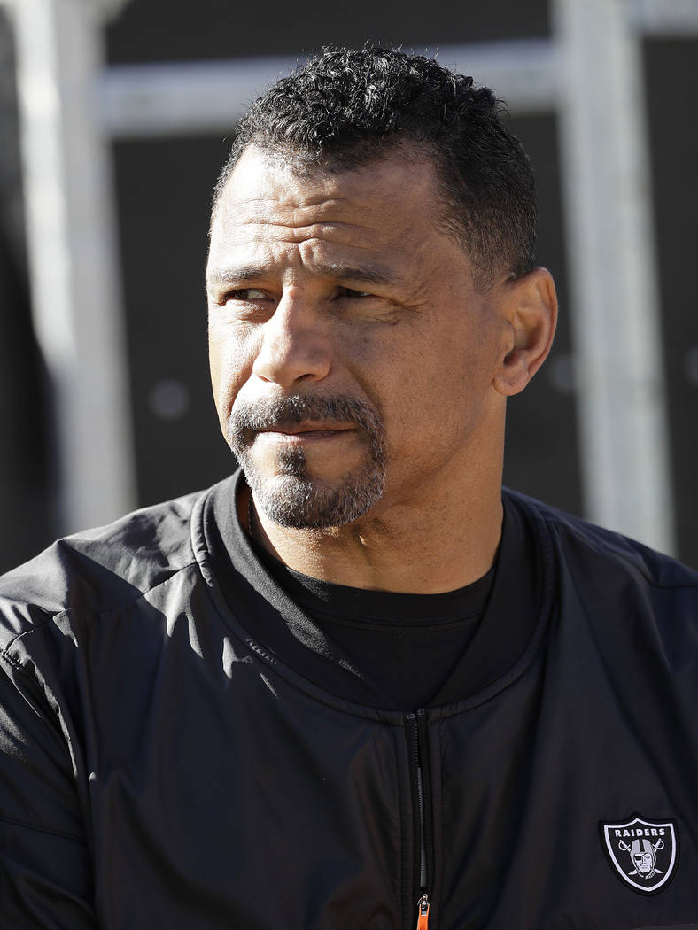 Oakland Raiders assistant coach Rod Woodson watches before an NFL football game between the Oakland Raiders and the Indianapolis Colts in Oakland, Calif., Saturday, Dec. 24, 2016. (AP Photo/Marcio ...