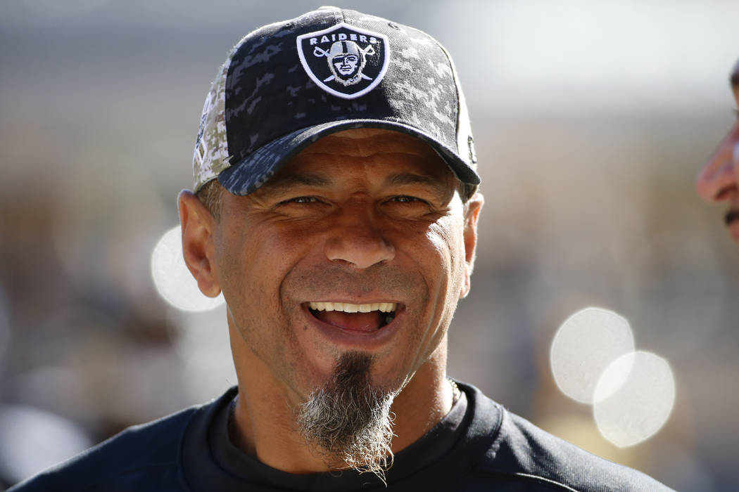 Oakland Raiders coach Rod Woodson visits on the sidelines before an NFL football game against the Pittsburgh Steelers, Sunday, Nov. 8, 2015, in Pittsburgh. (AP Photo/Gene J. Puskar)