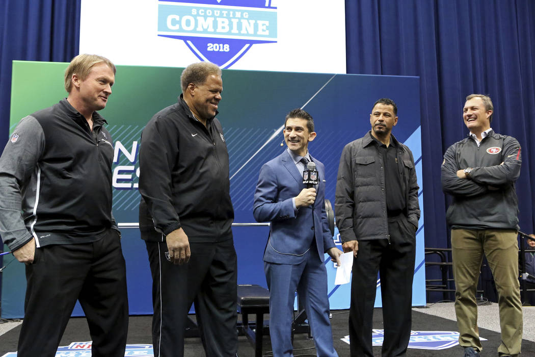 From left, Oakland Raiders head coach Jon Gruden, GM Reggie McKenzie, NFL Network host Andrew Siciliano, Hall of Famer Rod Woodson and San Francisco 49ers GM John Lynch are seen at the official co ...
