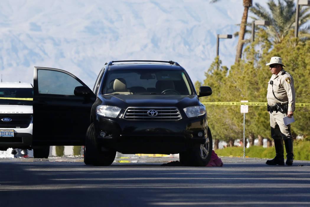Police investigate the scene of a fatal crash near Jack Leavitt Street and Riverdance Avenue in Las Vegas on Friday, March 23, 2018. Andrea Cornejo Las Vegas Review-Journal @dreacornejo