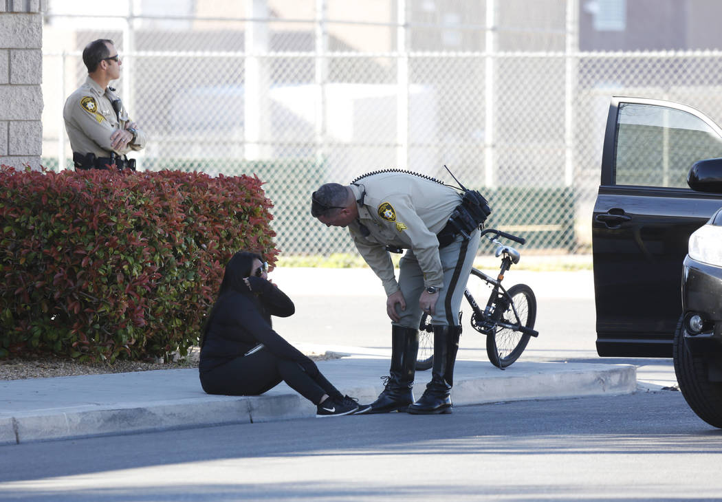 Police talk to a woman while investigating a fatal crash near Jack Leavitt Street and Riverdance Avenue in Las Vegas on Friday, March 23, 2018. Andrea Cornejo Las Vegas Review-Journal @dreacornejo