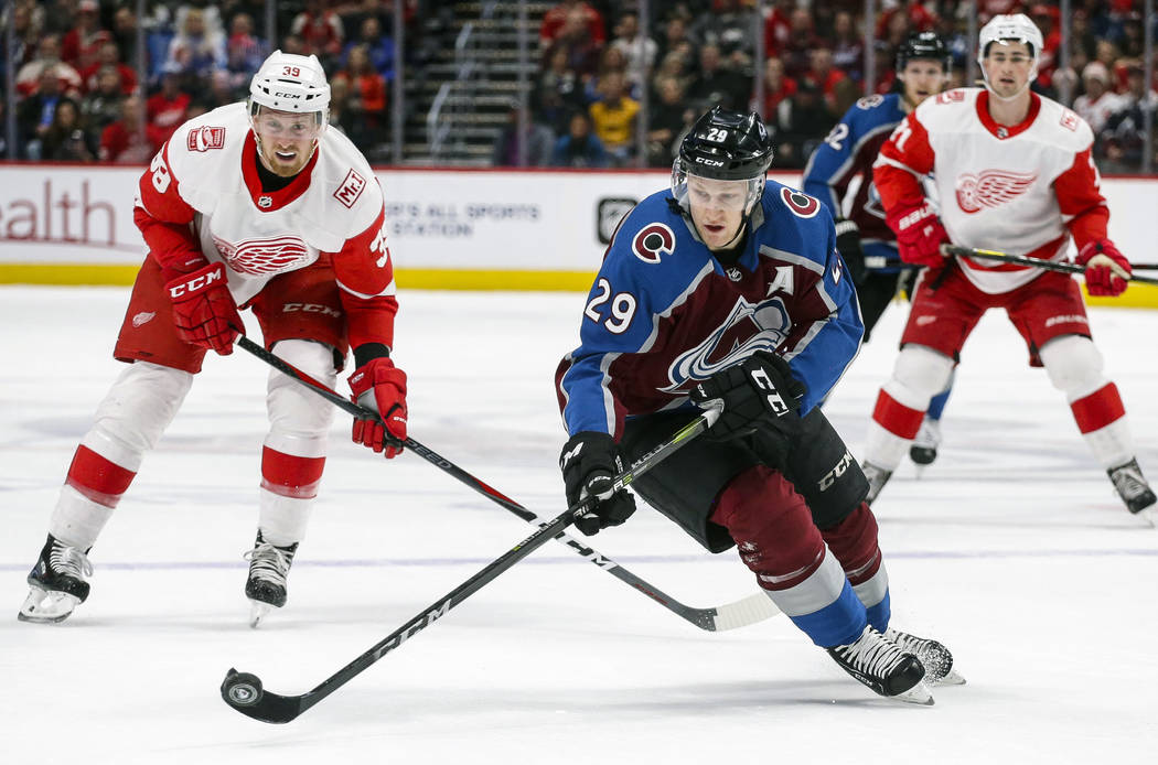 Colorado Avalanche center Nathan MacKinnon skates against Detroit Red Wings right wing Anthony Mantha (39) during the first period of an NHL hockey game on Sunday, March 18, 2018, in Denver. (AP P ...