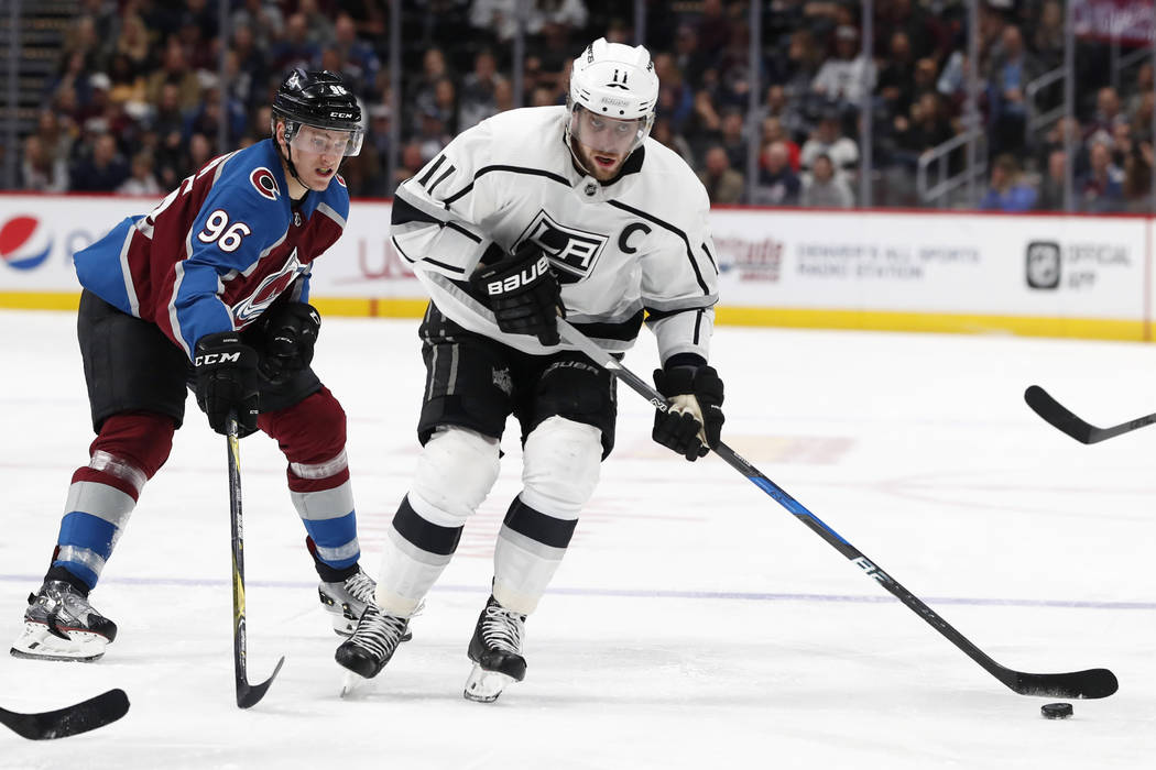 Los Angeles Kings center Anze Kopitar, right, drives past Colorado Avalanche right wing Mikko Rantanen in the second period of an NHL hockey game Thursday, March 22, 2018, in Denver. (AP Photo/Dav ...