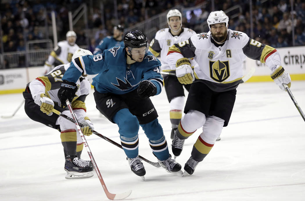 San Jose Sharks' Tomas Hertl (48) races against Vegas Golden Knights' Deryk Engelland (5) during the second period of an NHL hockey game Thursday, March 22, 2018, in San Jose, Calif. (AP Photo/Mar ...
