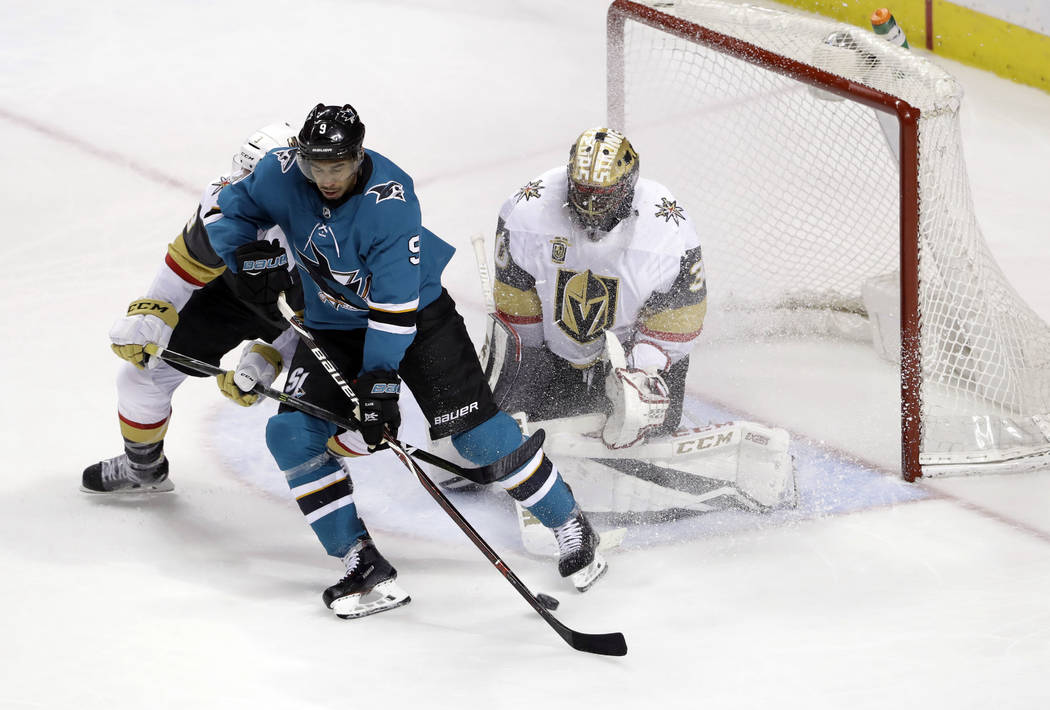 Vegas Golden Knights goaltender Malcolm Subban, right, stops a shot next to San Jose Sharks' Evander Kane during the third period of an NHL hockey game Thursday, March 22, 2018, in San Jose, Calif ...
