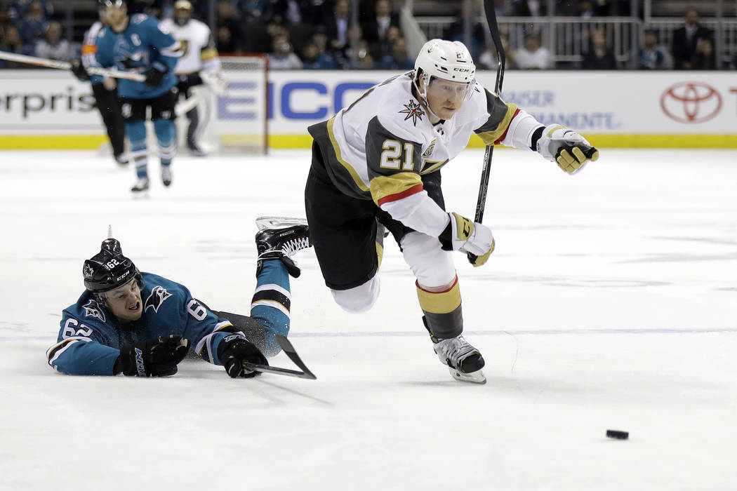 Vegas Golden Knights' Cody Eakin (21) skates past San Jose Sharks' Kevin Labanc during the first period of an NHL hockey game Thursday, March 22, 2018, in San Jose, Calif. (AP Photo/Marcio Jose Sa ...