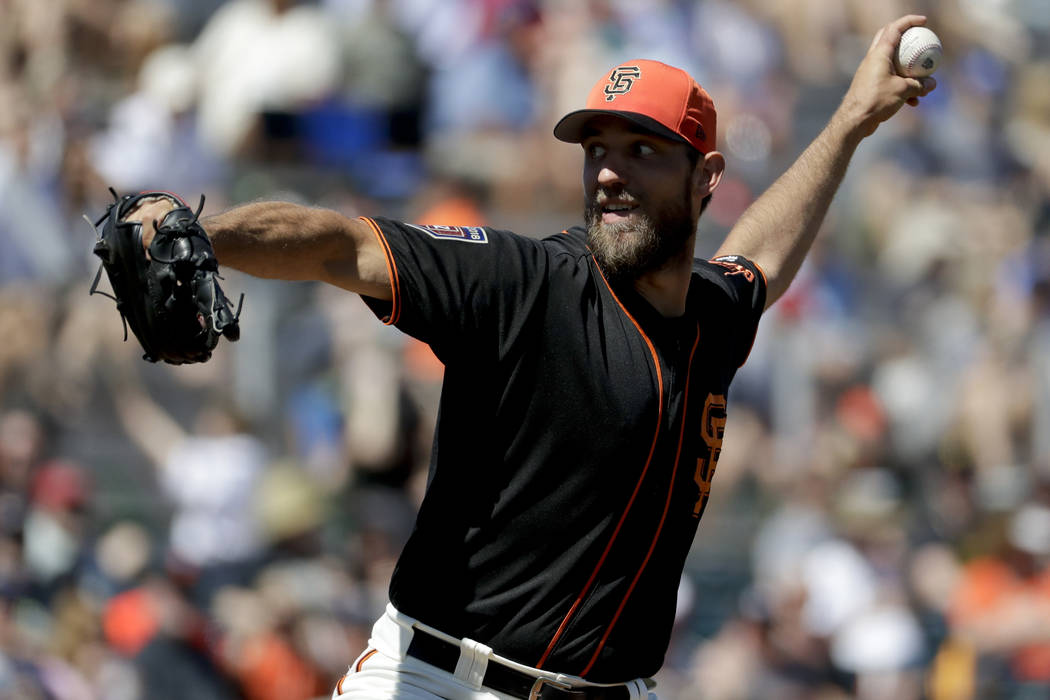 San Francisco Giants starting pitcher Madison Bumgarner throws against the Kansas City Royals during the first inning of a spring baseball game in Scottsdale, Ariz., Friday, March 23, 2018. (AP Ph ...