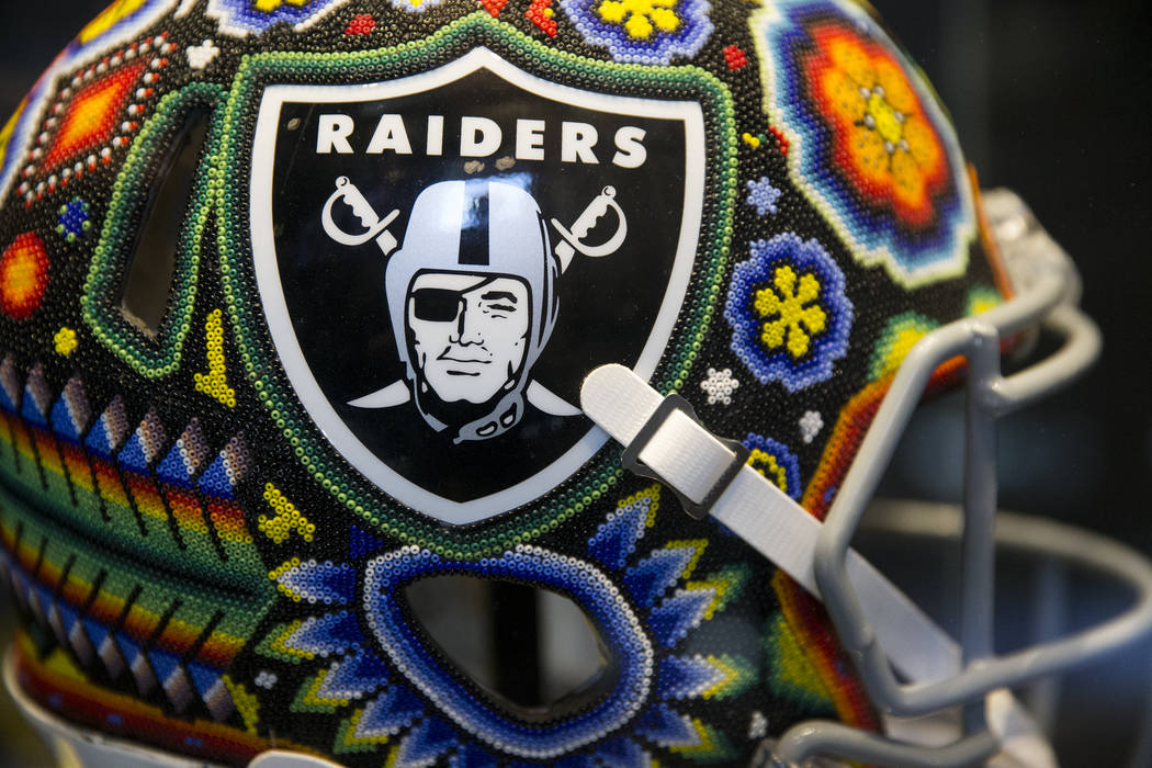 A Huichol art decorated helmet on display in the Raiders Preview Center at Town Square Las Vegas in Las Vegas, Tuesday, Feb. 6, 2018. (Erik Verduzco/Las Vegas Review-Journal)  @Erik_Verduzco