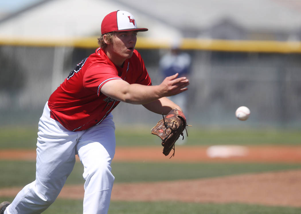 Las Vegas pitcher Brandon Culmo tosses to first base in the second  inning of a baseball game against Rim of the World (Calif.) at Las Vegas High School Monday, March 26, 2018. K.M. Cannon Las Veg ...