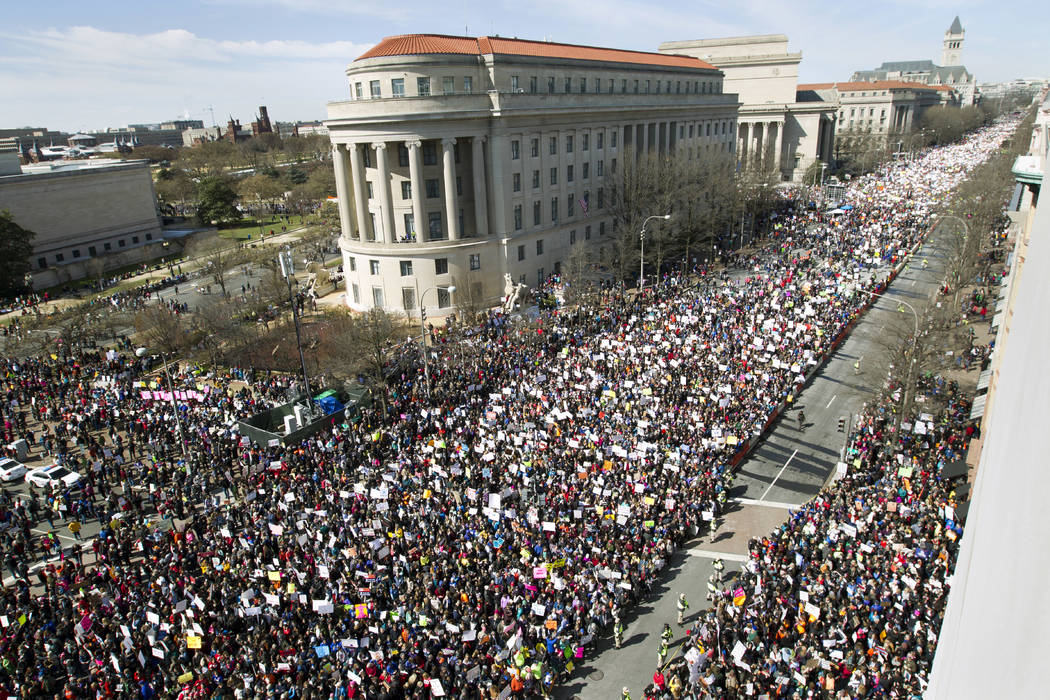 "As seen from the Newseum, people fill Pennsylvania Avenue during the ""March for Our Lives"" rally in support of gun control in Washington, Saturday, March 24, 2018. (AP Photo/Jose Luis Ma ..."